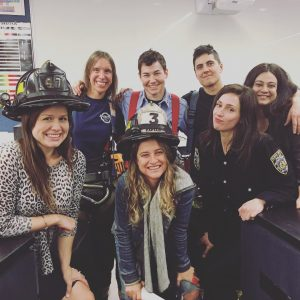 Christina Kallas with FDNY women firefighters and The Rainbow Experiment cast members Nina Mehta, Booker Garrett and Margaret Champagne.
