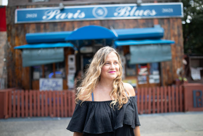 Christina Kallas in front of Paris is in Harlem's main location, photographed by Lauren Sowa